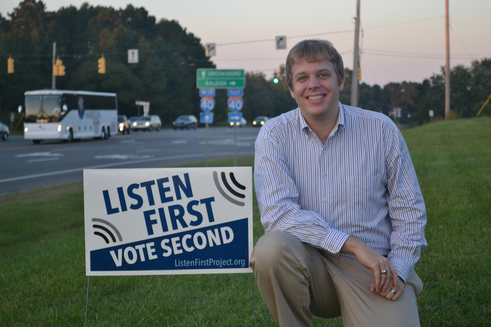 Pearce Godwin, Founder & President of Listen First Project, with 2014 Election Season Political Signage