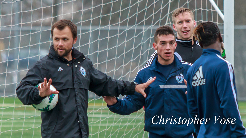 Jake DeClute, Russell Teibert, and Simon Thomas discuss how to defend a corner at the Burnaby Lake Sports Complex on 11 February 2013.