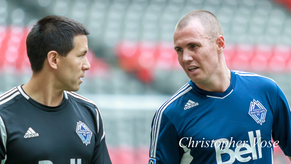 Mike Young discusses fitness issues with Kenny Miller at BC Place on 17 July 2012.