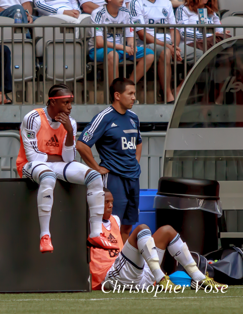 Substitutes Darren Mattocks and Carlyle Mitchell take a break after warming up with Mike Young at BC Place on 1 September 2013.