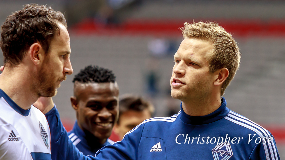 Andy O'Brien and Jay DeMerit speak before a match at BC Place on 2 March 2013.