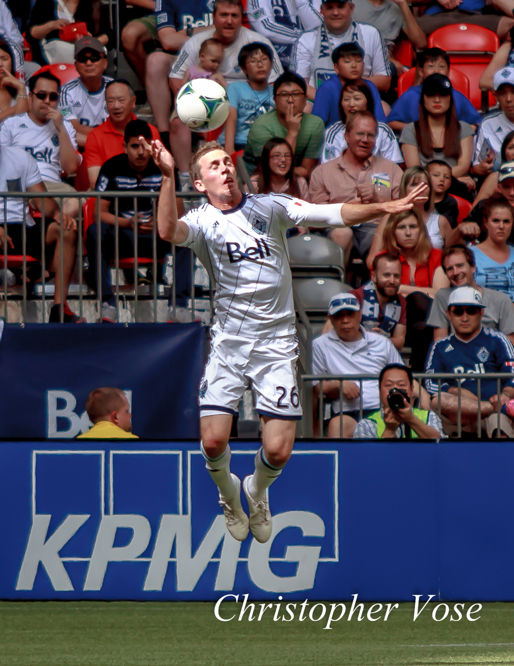Corey Hertzog heads the ball at BC Place on 14 July 2013.