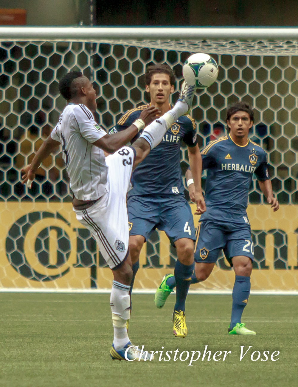 Gershon Koffie shows off his athleticism to Omar Gonzalez and A.J. DeLaGarza at BC Place on 11 May 2013.