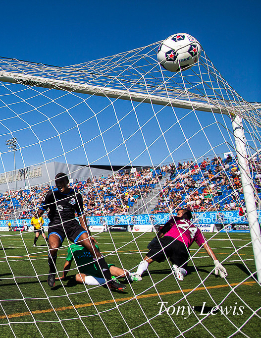 FC Edmonton's Chris Nurse scores a goal against New York Cosmos at Clarke Stadium on 20 October 2013.
