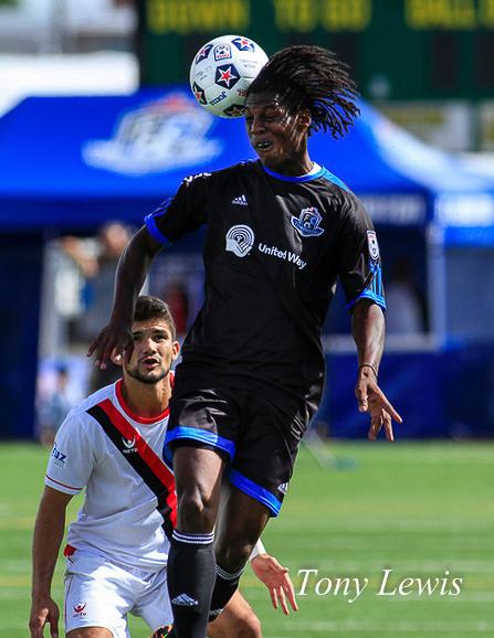 FC Edmonton's Anthony Adur leaps over Atlanta Silverbacks FC's Alberto Navarro at Clarke Stadium on 18 August 2013.