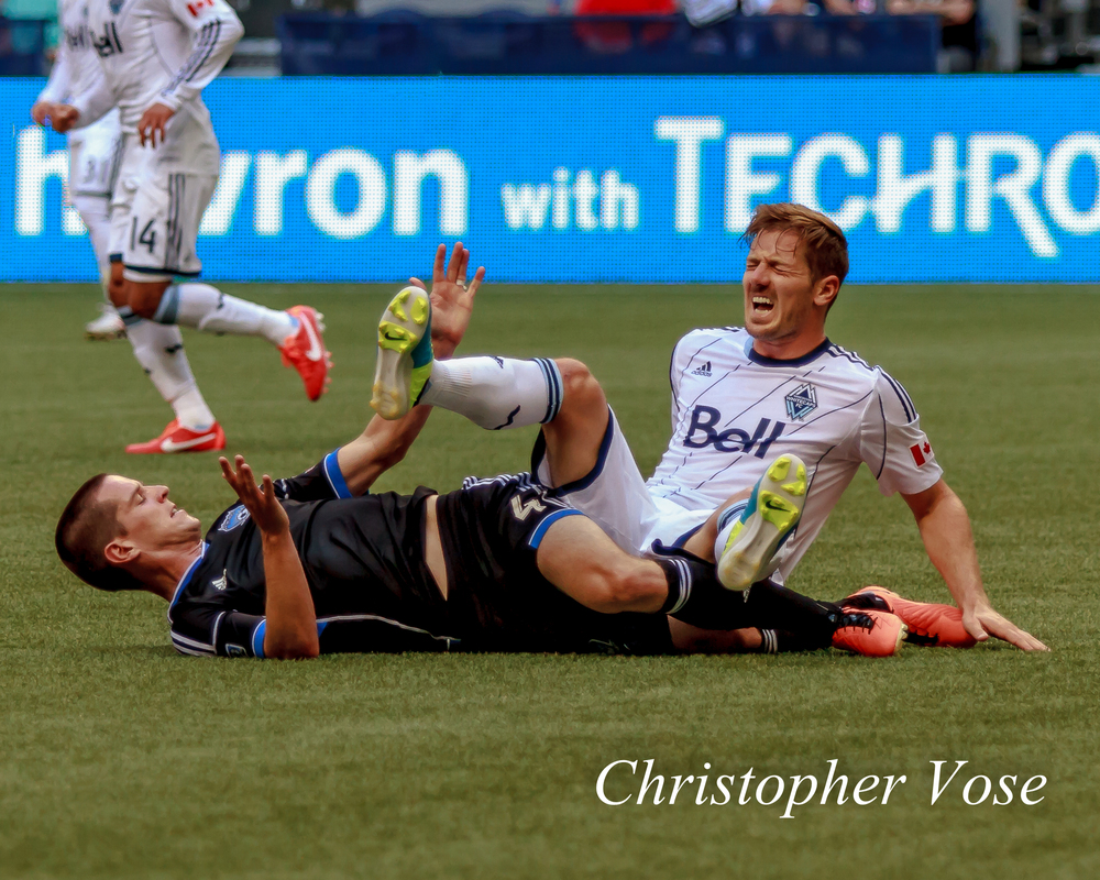 San Jose's Sam Cronin takes out Vancouver Jordan Harvey with a late tackle.