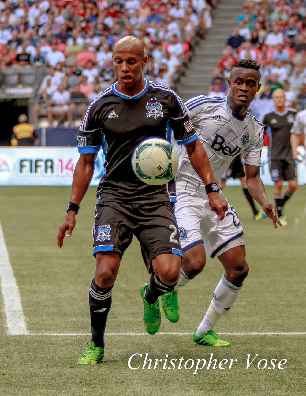 Jordan Stewart and Gershon Koffie chase the ball.