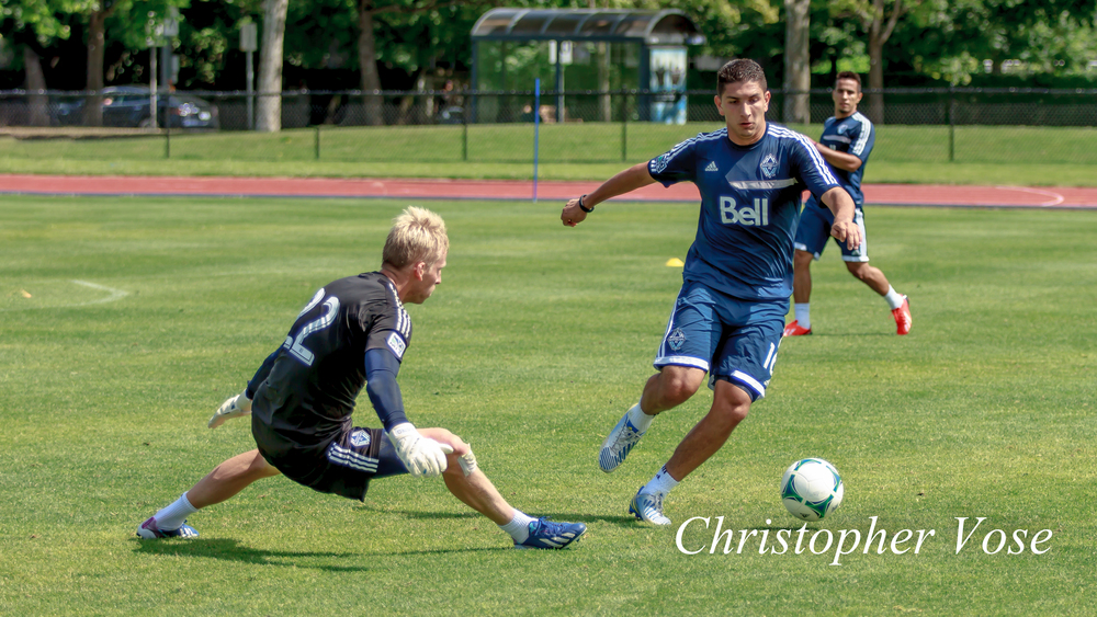 Johnny Leverón tries to slip past Vancouver goalkeeper David Ousted at the National Soccer Development Centre.