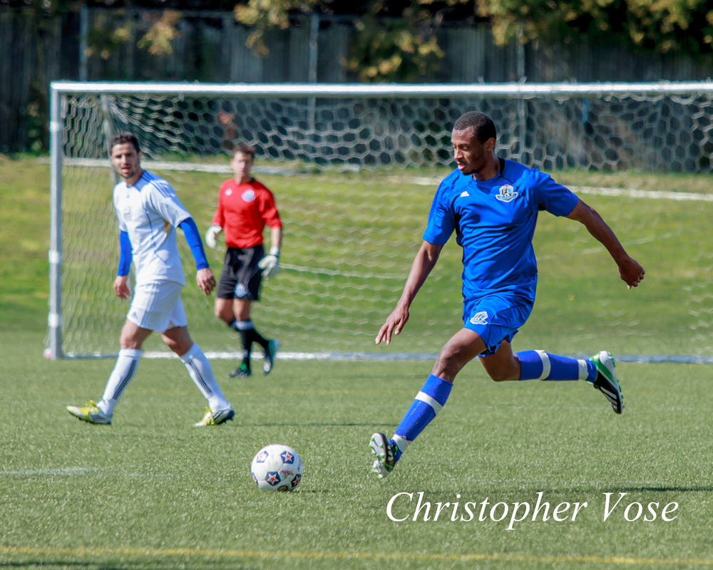 Michael Cox, then of FC Edmonton, takes on UBC at Thunderbird Stadium on 29 March 2013.