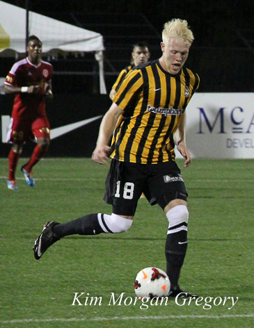 Jackson Farmer plays the ball at Battery Park on 29 March 2014.