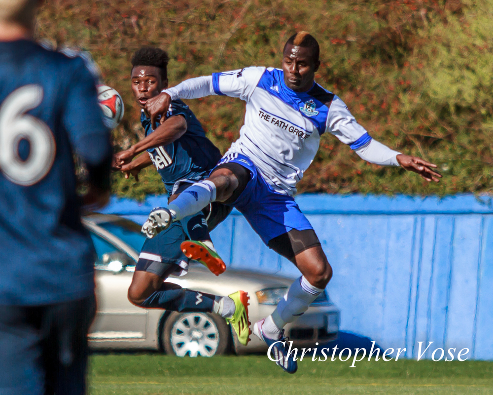 Substitutes Sam Adekugbe and Horace James battle in the air for the ball. Either that, or they're hoping to land parts in a Matrix reboot.