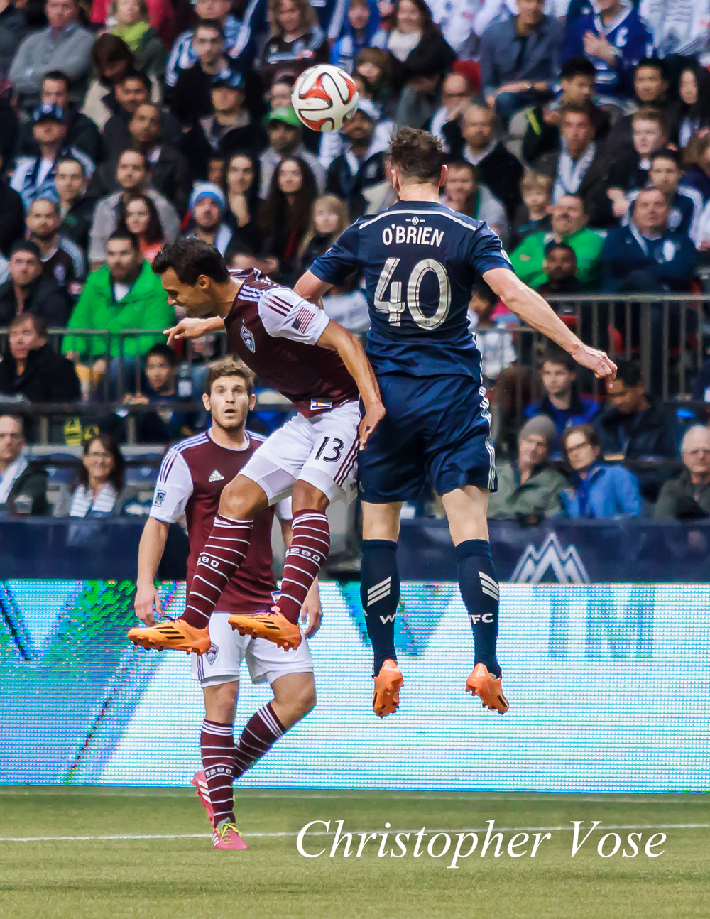 Andy O'Brien wins an aerial duel with Colorado's Kamani Hill at BC Place on 5 April 2014.