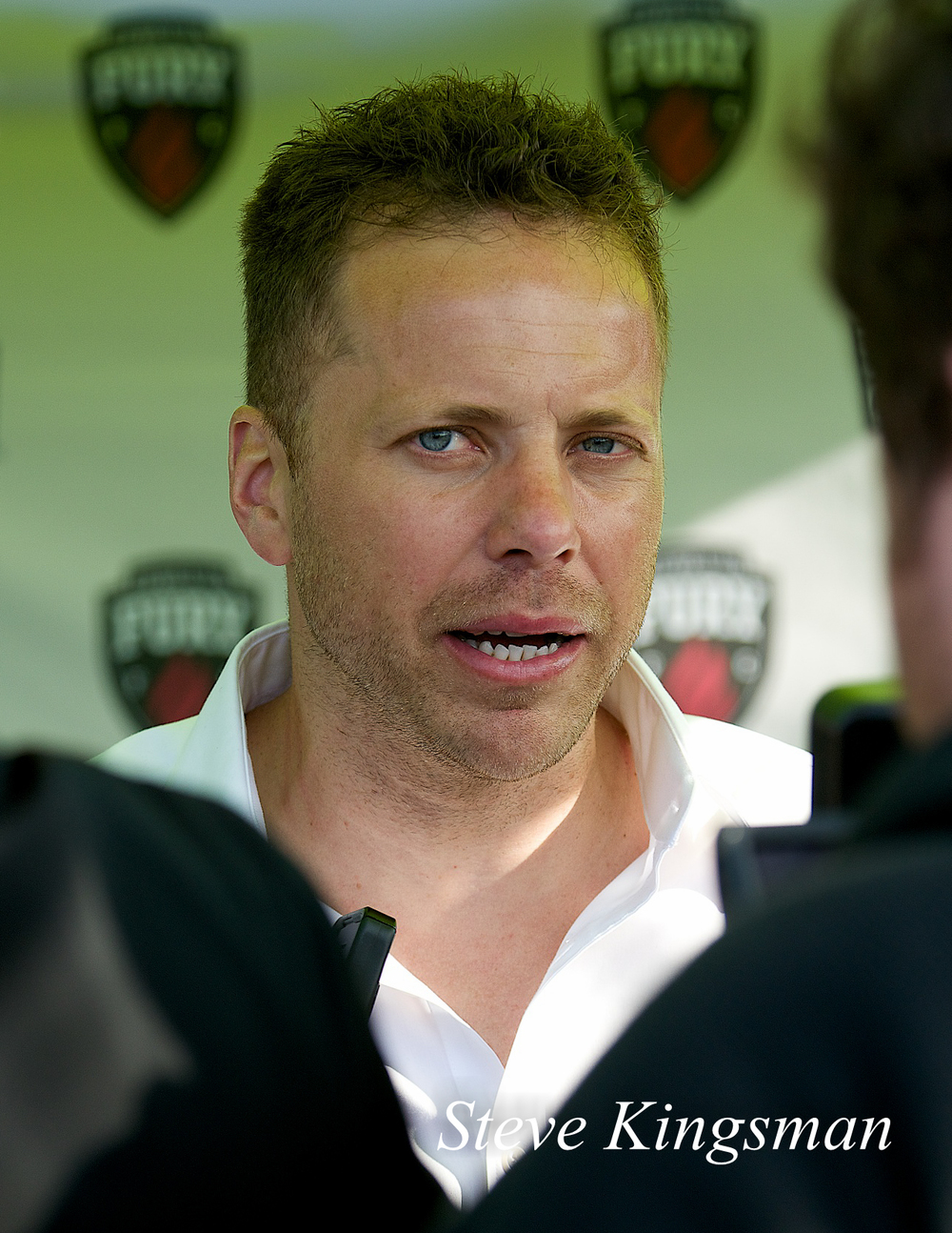 Ottawa manager Marc Dos Santos facing the media at Harris Stadium.