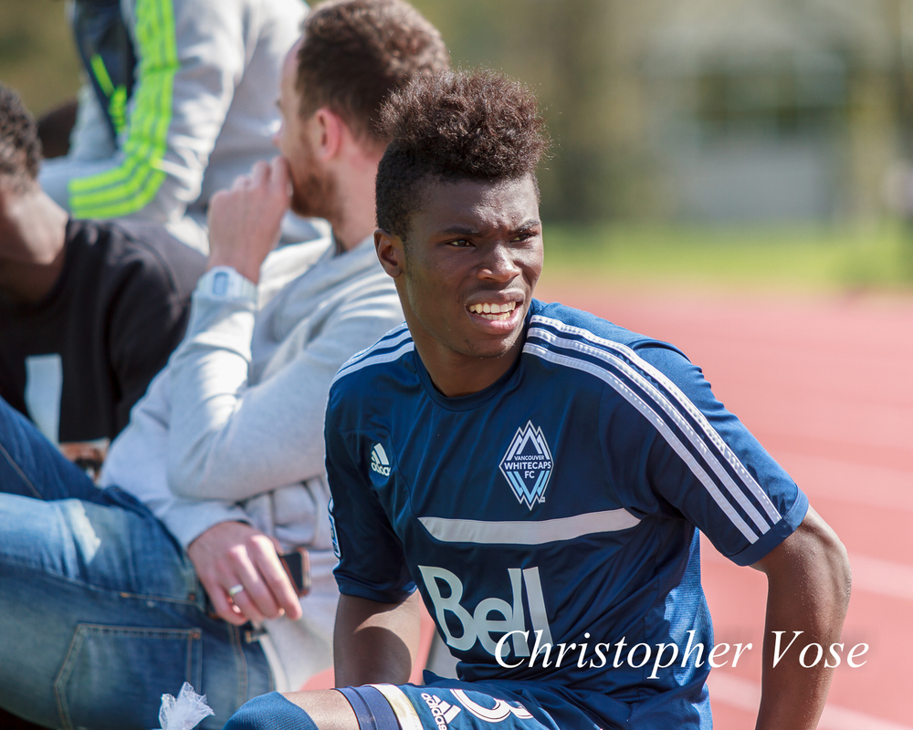 Sam Adekugbe takes a seat after being substituted for Nicholas Prasad at halftime.