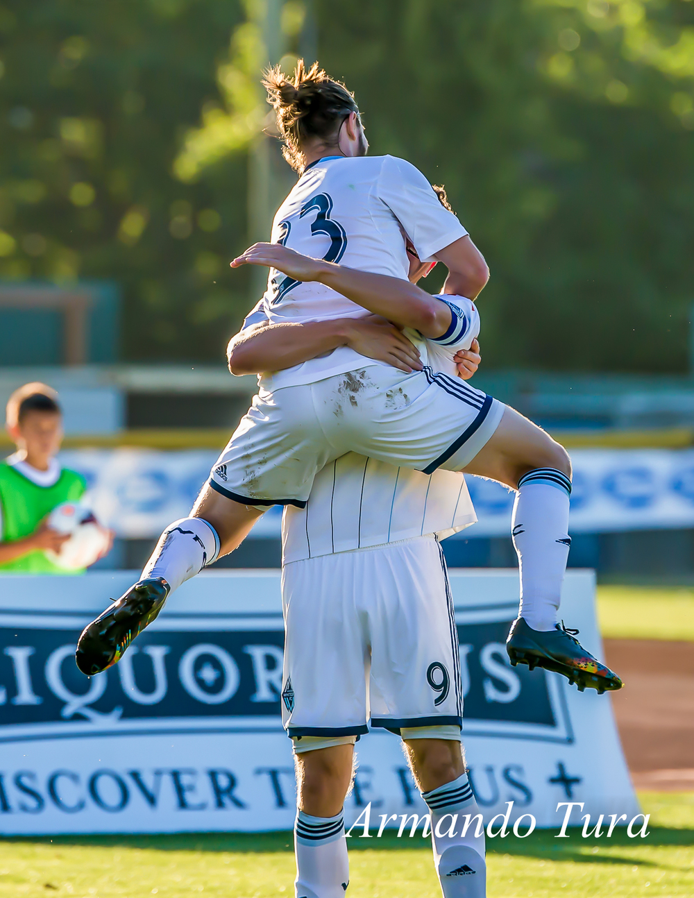 Reynold Stewart celebrates with Niall Cousens after they combined to make it a 4-0 first half for Vancouver at Royal Athletic Park.