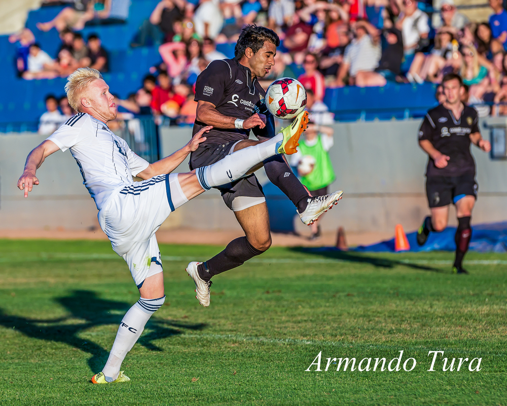 Vancouver's Jackson Farmer wins the ball in spite of Cam Hundal's superior positioning.