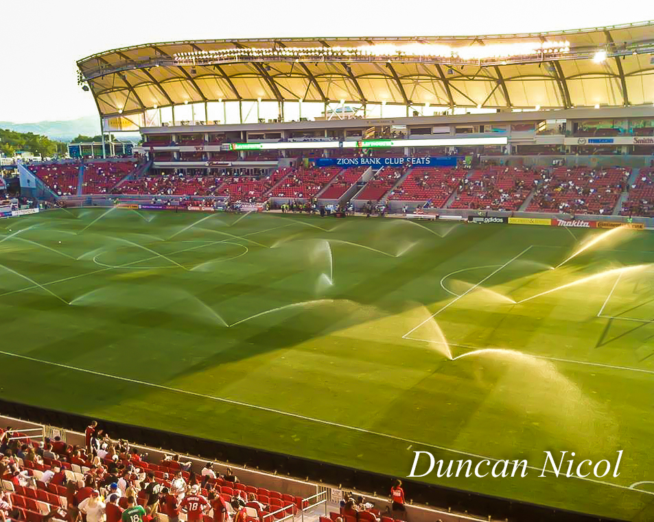 The ground staff water the pitch ahead of Salt Lake's match with Vancouver. Soon, the players would need that water in the hot desert sun.