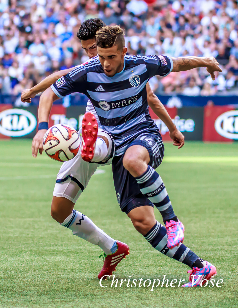 Kansas City's Dom Dwyer may have had the better positioning, but Vancouver's Matías Laba wanted the ball more.