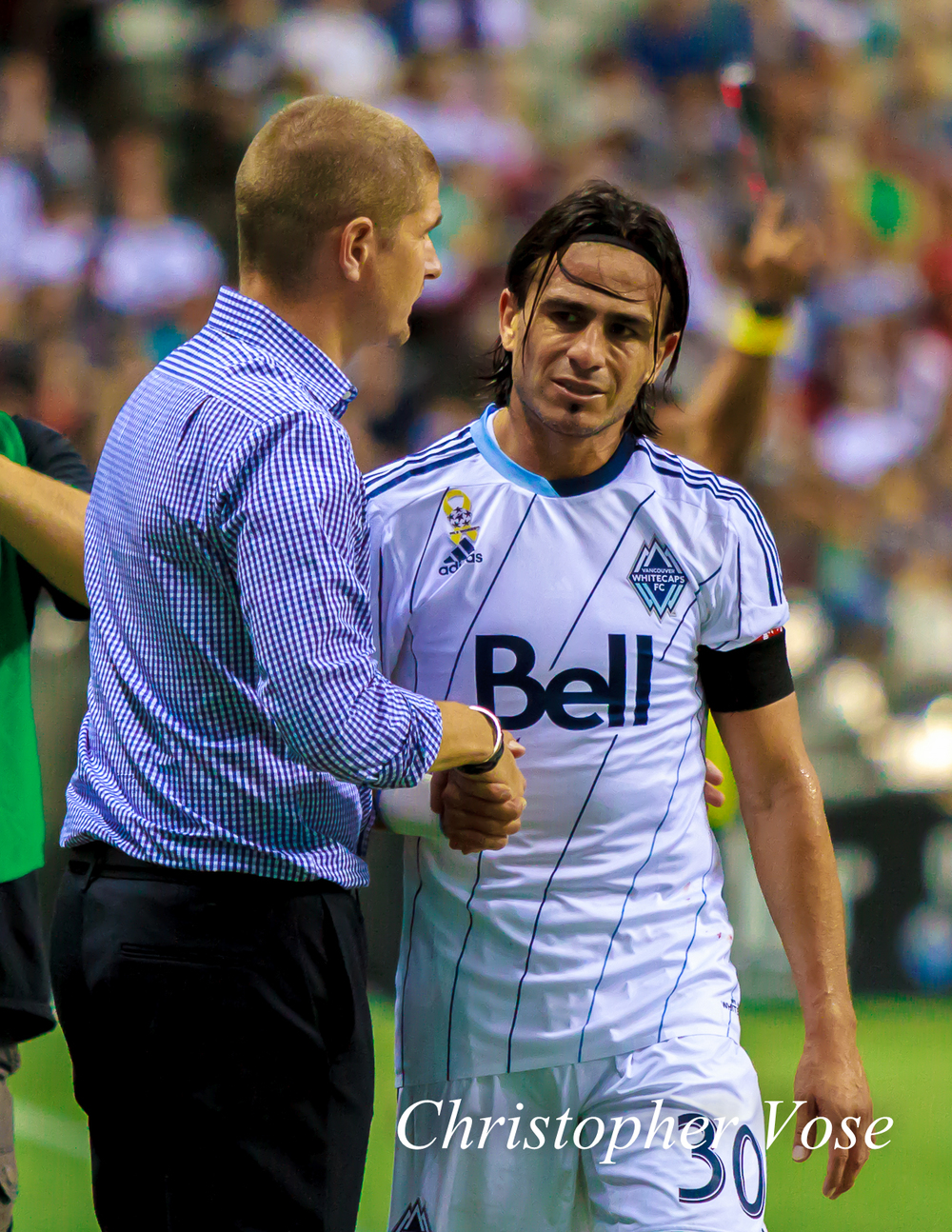 Mauro Rosales is greeted by his manager, Carl Robinson, after another fine performance for Vancouver Whitecaps FC.