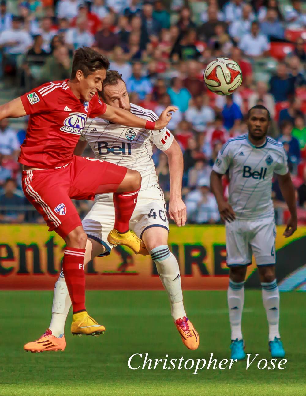 David Texeira and Andy O'Brien clash at BC Place as Kendall Waston looks on from the back.