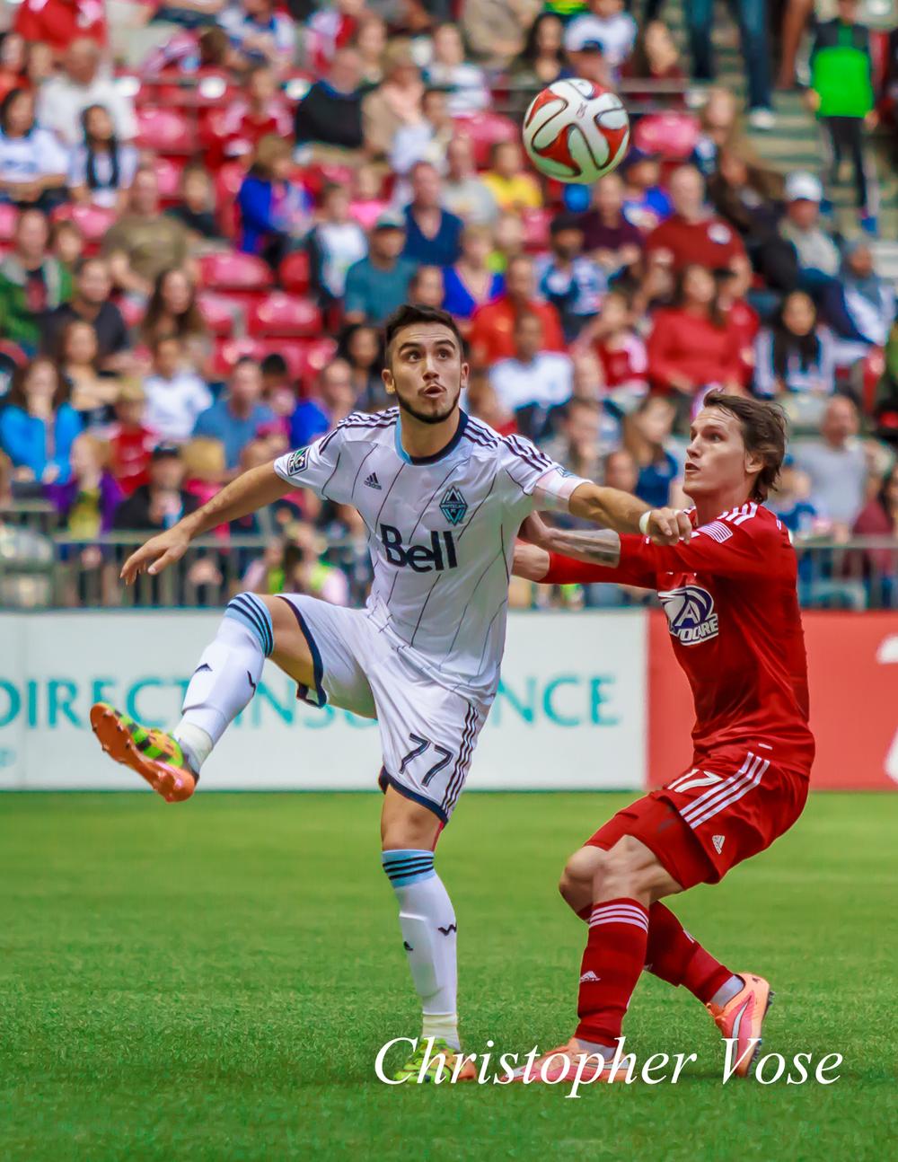 Vancouver Captain Pedro Morales battles with Dallas' Zach Loyd