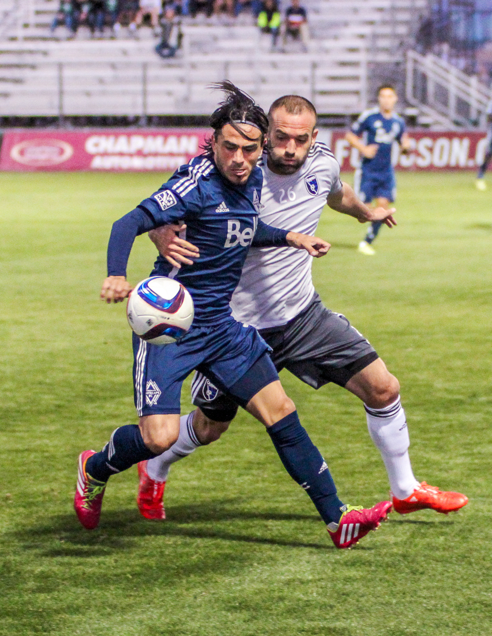 Brandon Barklage battles with Mauro Rosales in the second half of their friendly in Tucson, Arizona. Photo provided by Vancouver Whitecaps FC.
