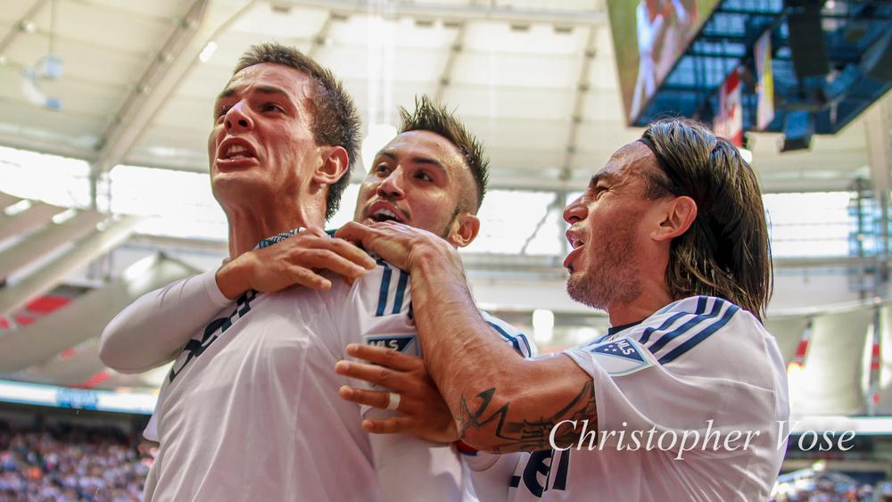 Octavio Rivero, Pedro Morales, and Mauro Rosales celebrate Rivero's goal in front of the Curva Collective.