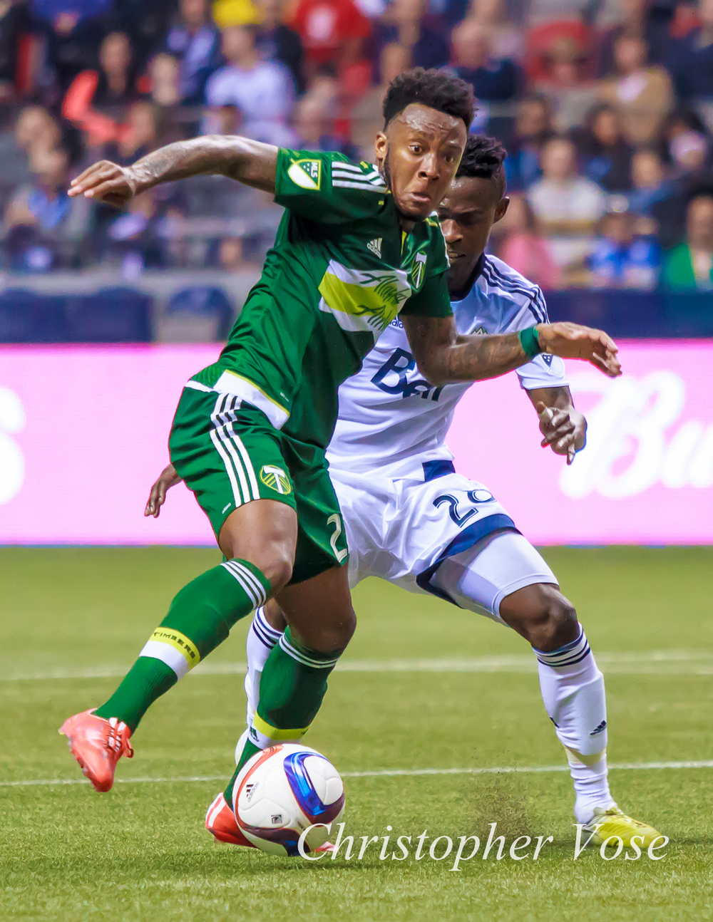 Rodney Wallace and Gershon Koffie battle for the ball in the first match of the 2015 Cascadia Cup.