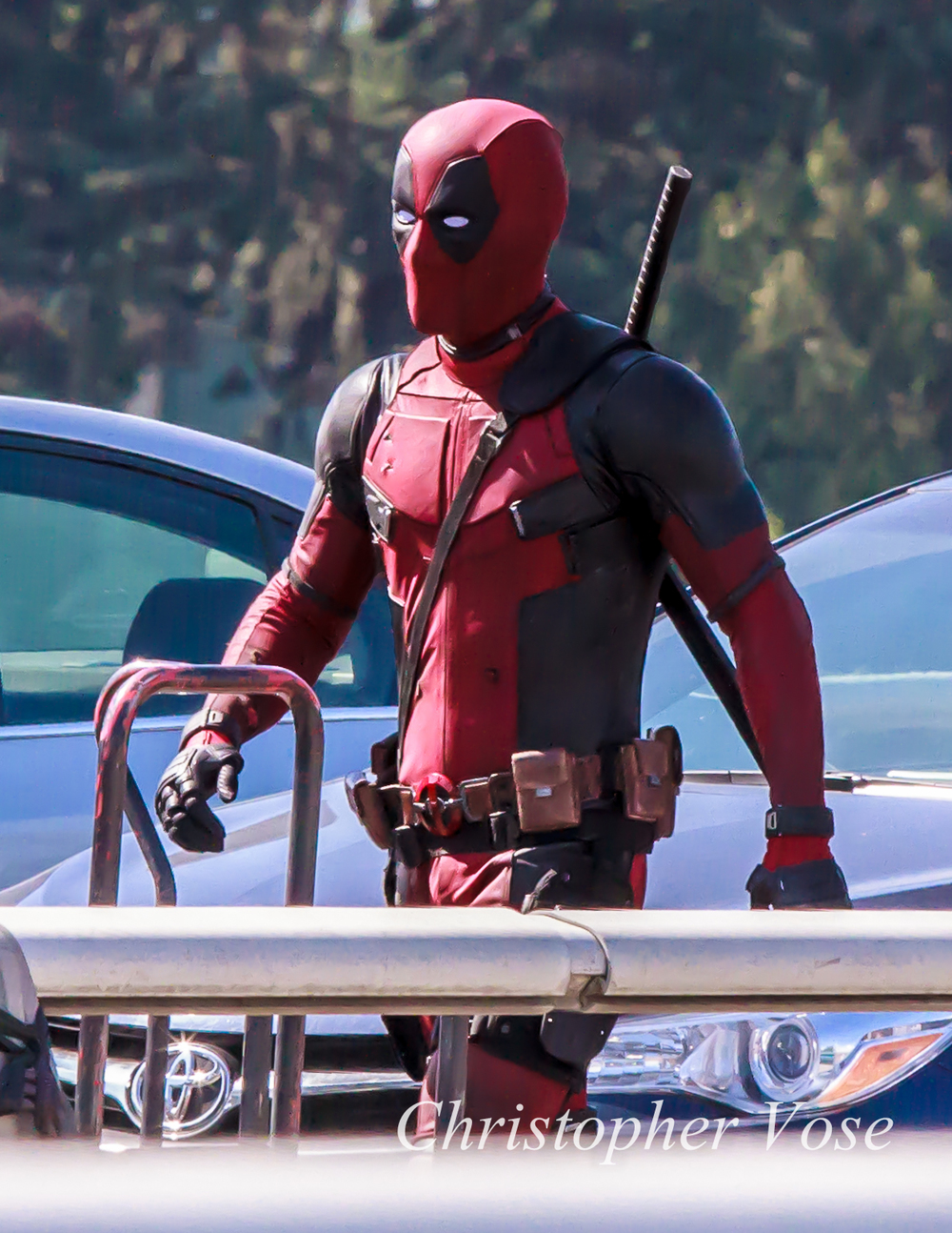 Ryan Reynolds in costume and on the set of Deadpool.