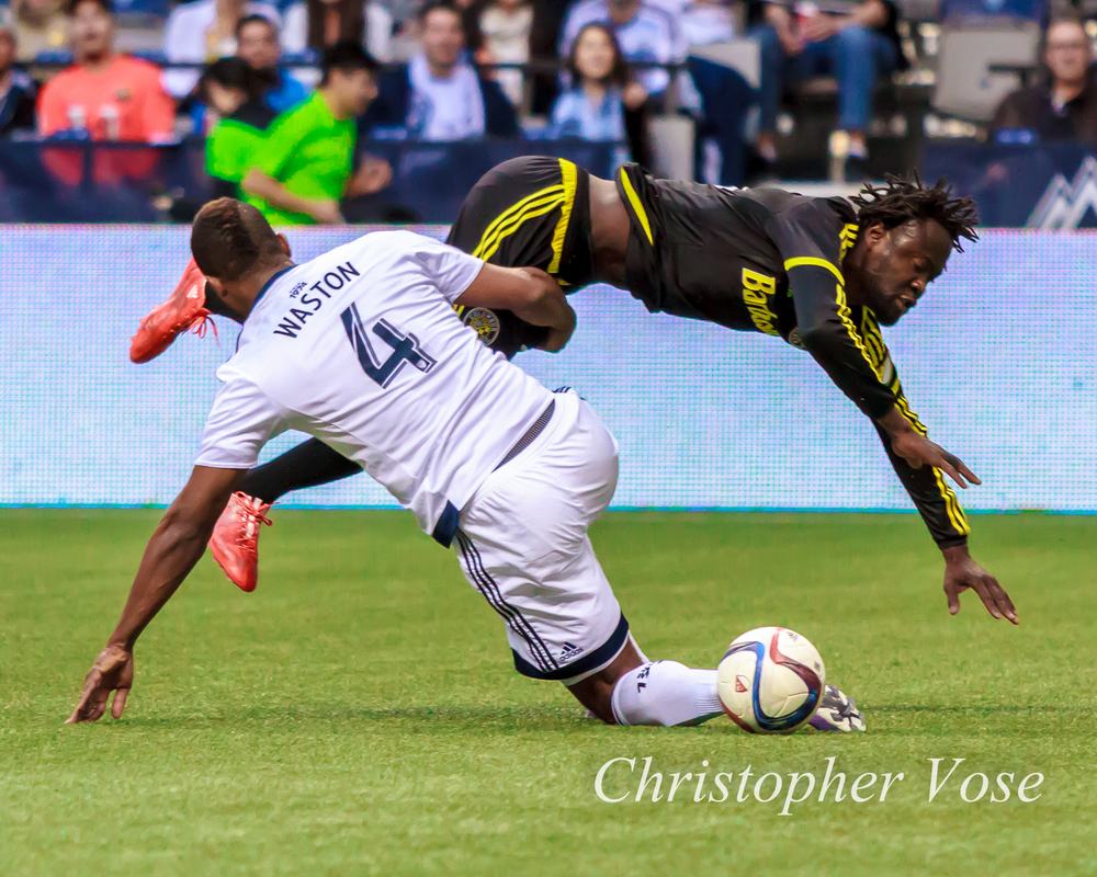Kendall Waston earns a yellow card for this foul on Kei Kamara.