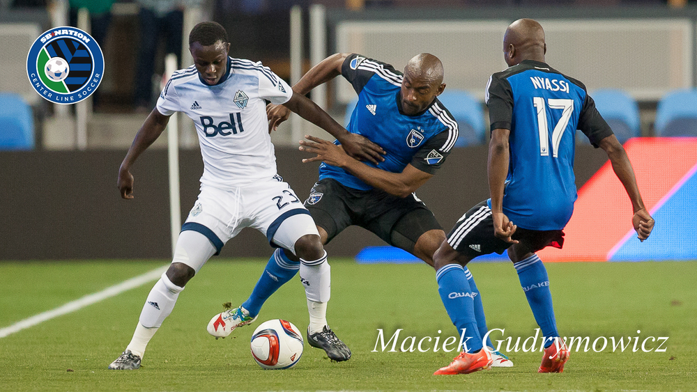 Kekuta Manneh battles with Víctor Bernárdez as Sanna Nyassi looks on.