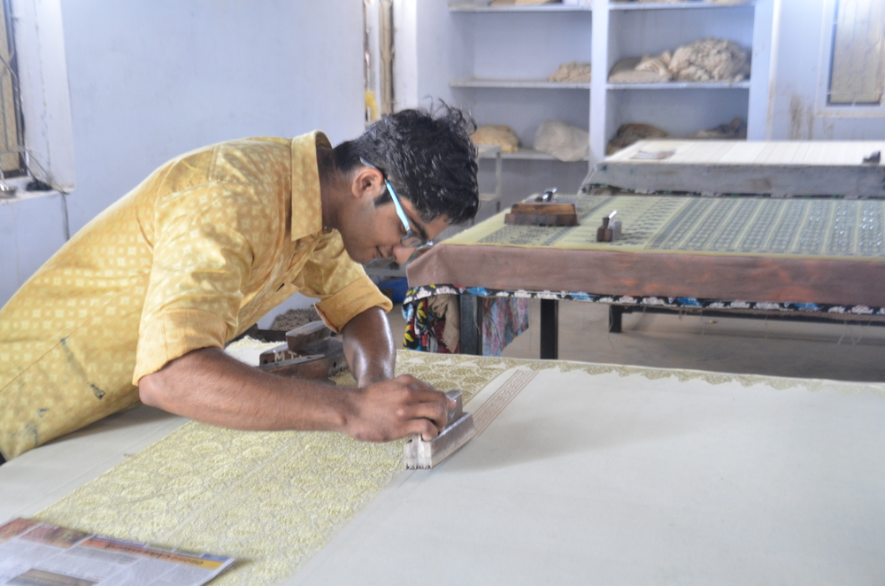 Musa Bhai's younger son, Anas, block-prints fabric