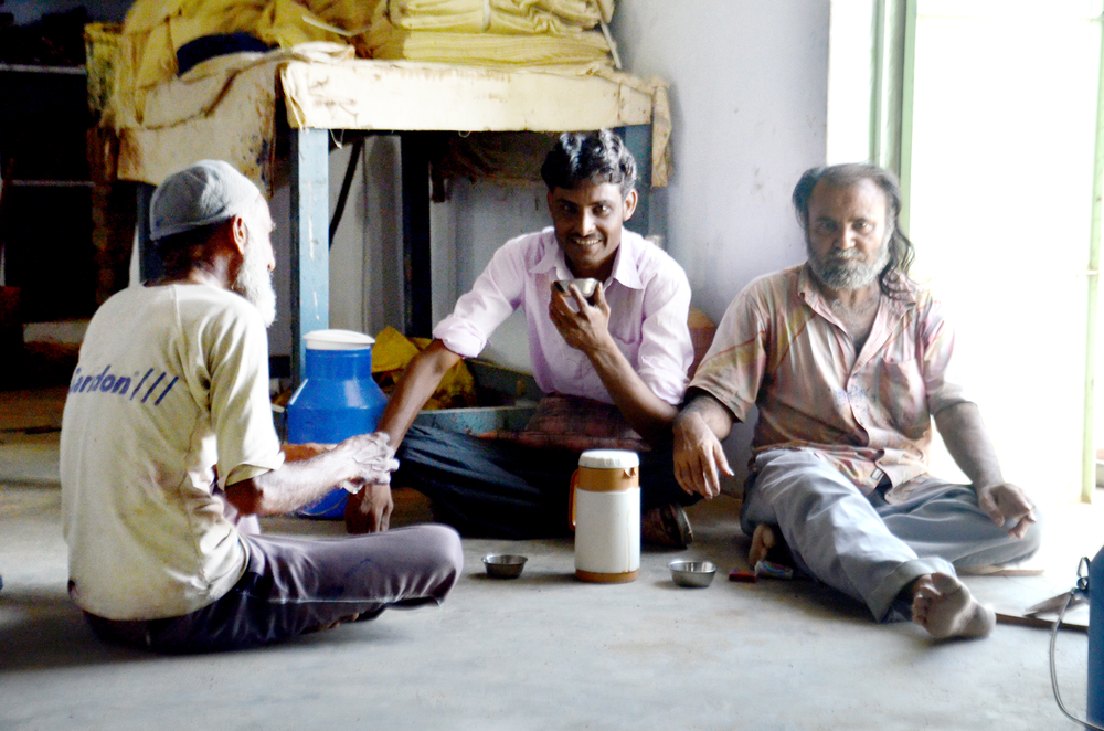 Block-print artisans at Musa Bhai's family workshop enjoy a tea break