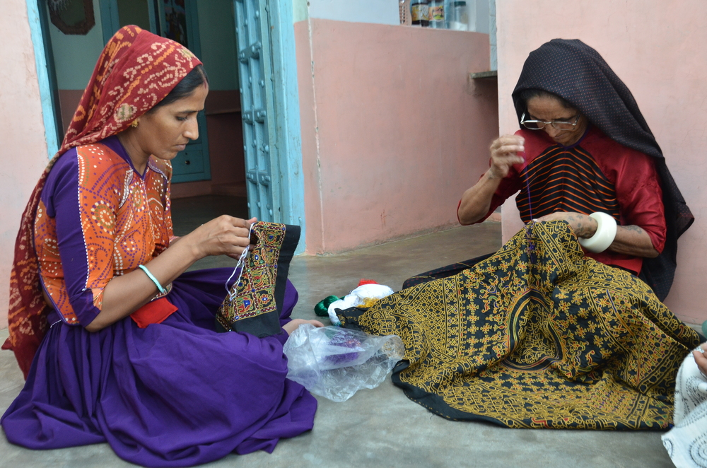 Embroidery has a communal element to it. Pictured here are Laxmi Bhen and her niece.