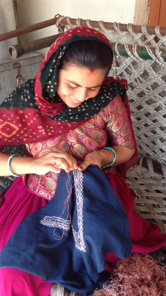 Geeta Bhen (Laxmi Bhen's daughter) working on an embroidered neckline for a REVIVAL Style dress