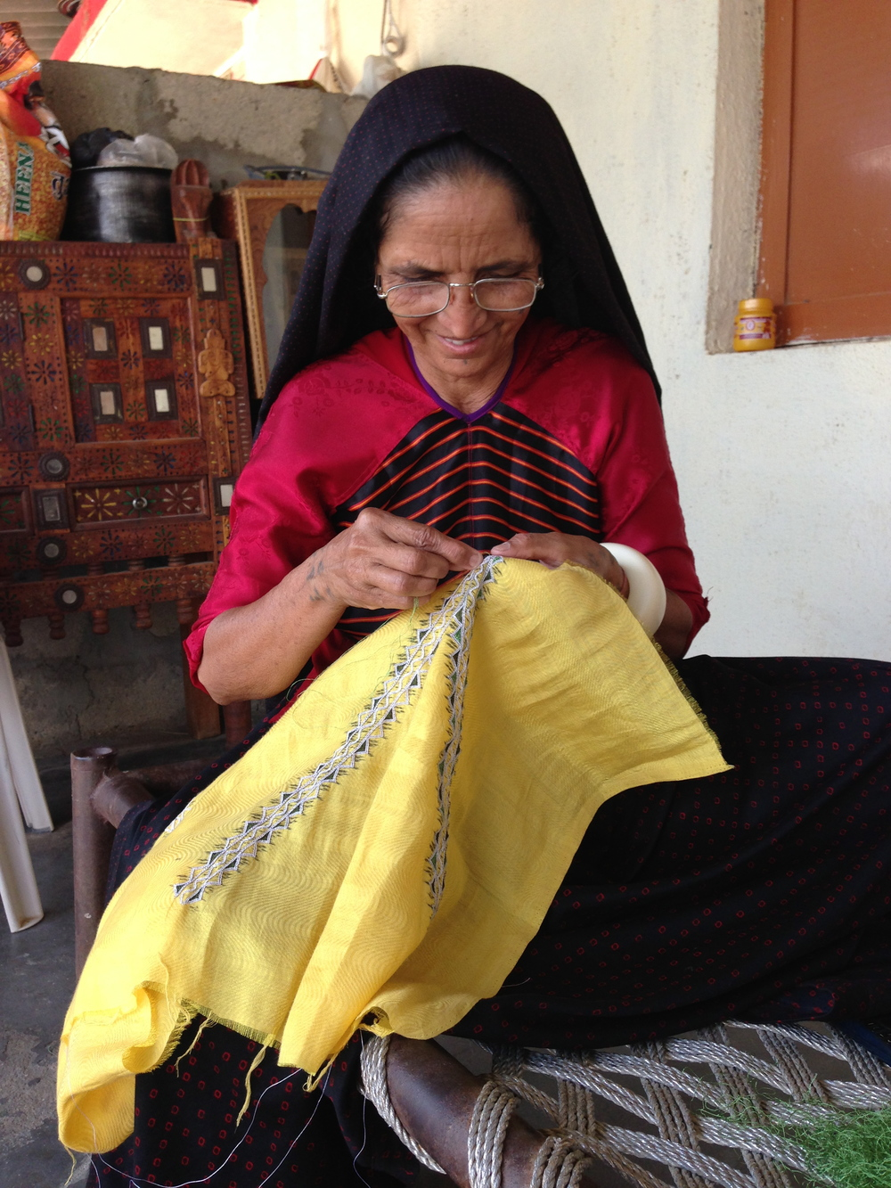 Laxmi Bhen embroiders the REVIVAL Style shimmery yellow dress