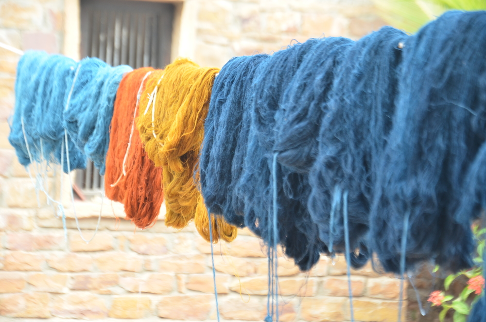 Vegetable-dyed yarn, drying in the sun