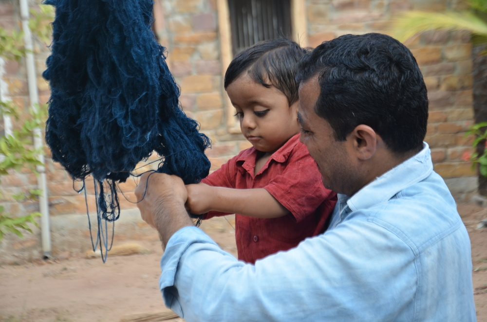 Even at the tender age of 2, ShyamJi Bhai's son, Niraj, has a keen interest in the family's craft tradition