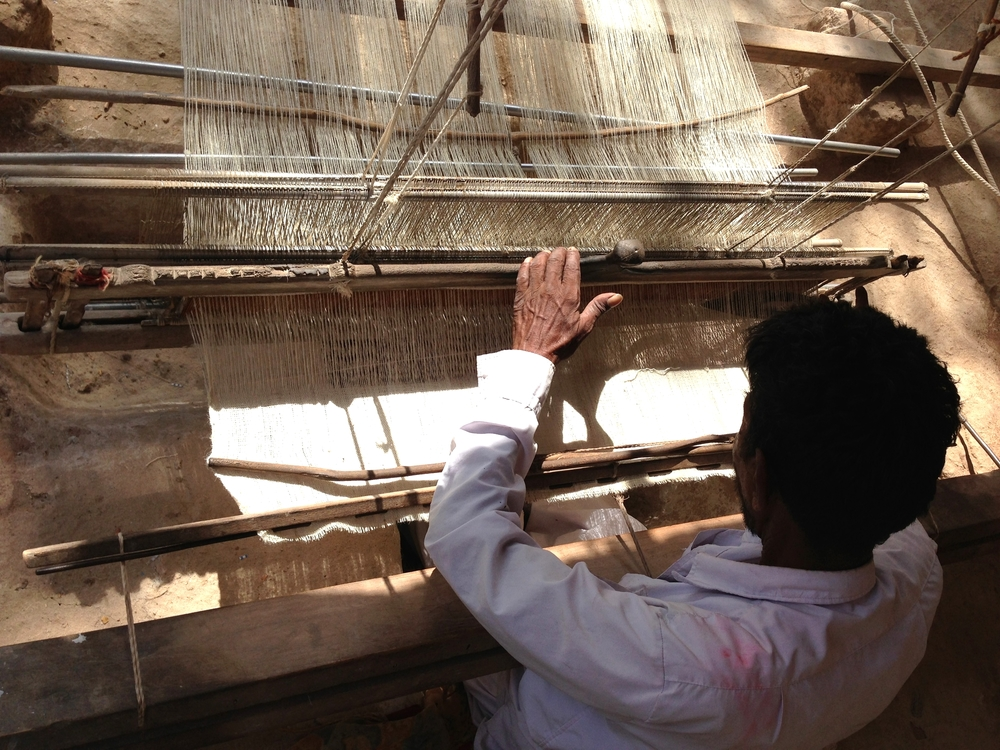 This weaver artisan, ShyamJi Bhai's Uncle, has developed the ability to weave kala organic cotton, enabling him to take on more weaving work
