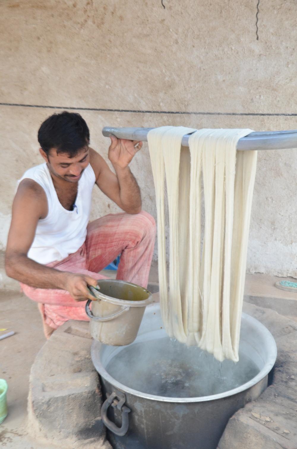 Dinesh Bhai prepares to dye some yarn