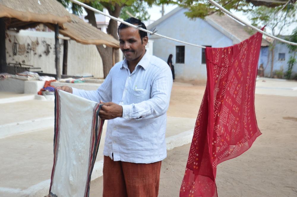 Arjun Bhai does quality control on a shawl
