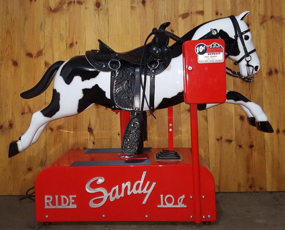 sandy_coin_horse_ride.jpg