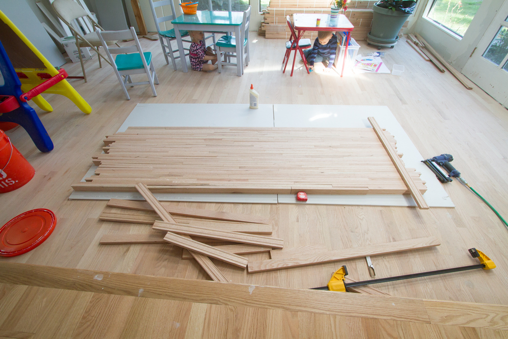 Diy butcher block countertops made from leftover flooring work laying a floor so that you dont get any weak areas the ends of what you lay out will be jagged thats ok youll cut them to size at the end solutioingenieria Gallery