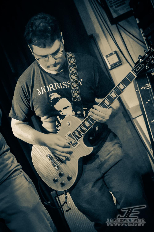 Matt Shomphe on Guitar and sporting a Morrissey T-shirt.