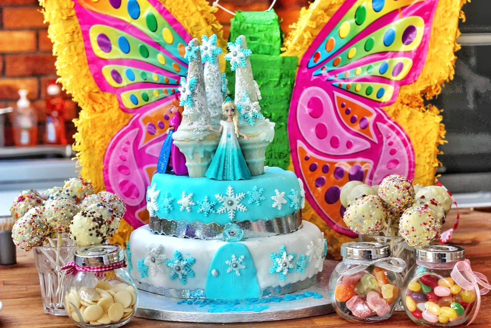 Niece's 6th Birthday 'Frozen Theme' two tier Chocolate Biscuit cake with accompanying White Chocolate Cake Pops