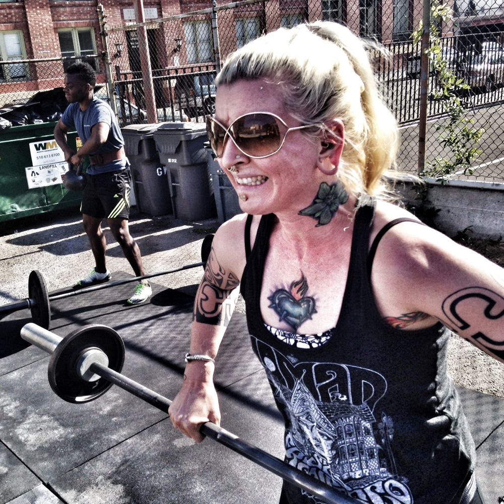 Lysa. 30 (Squat) Cleans. Badger Hero WOD.  Photo by Rafael Vega