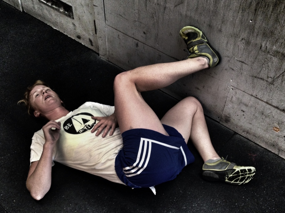 """Colleen after 11.3 + 750m Row + 50 Burpees. """"I've never worked so hard.""""  Photo by Rafael Vega"""