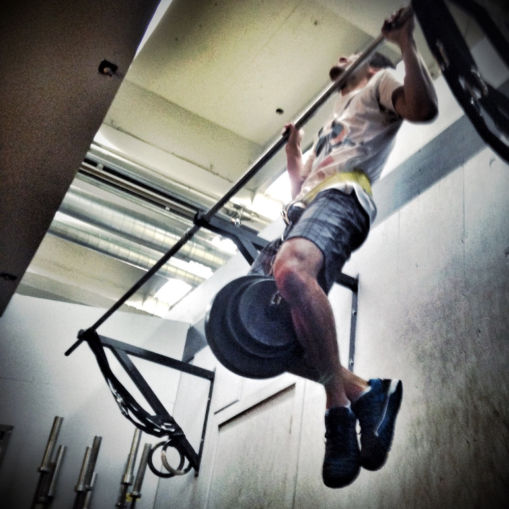 Patrick. Weighted Pull Ups (65 lbs. here).  Photo by Rafael Vega