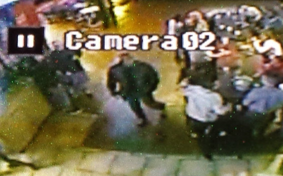 The photos I took of surveillance footage of Mike Anderson at a bar, around the time he was allegedly robbing someone.