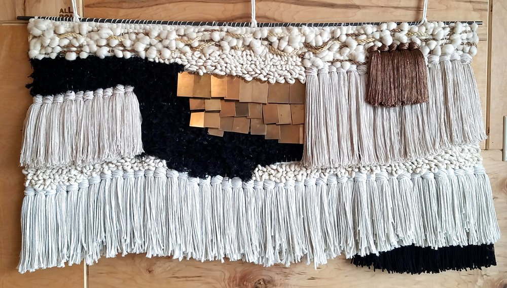 "Cotton, brass, wool, sisal, manilla, wool, viscose. Hangs from a steel rod.  48"" w x 24"" h.  2018. Sold."